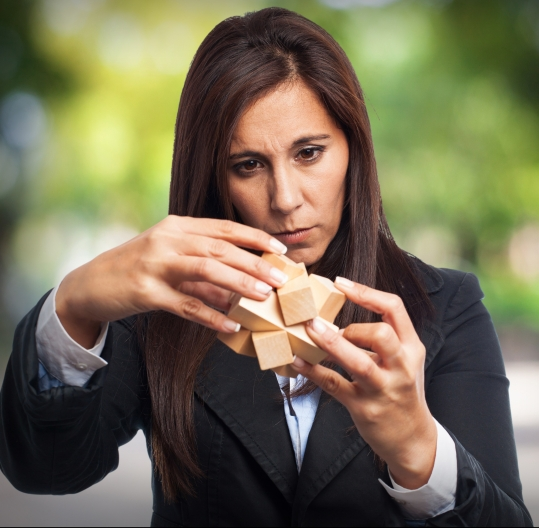 cool business-woman with puzzle cube
