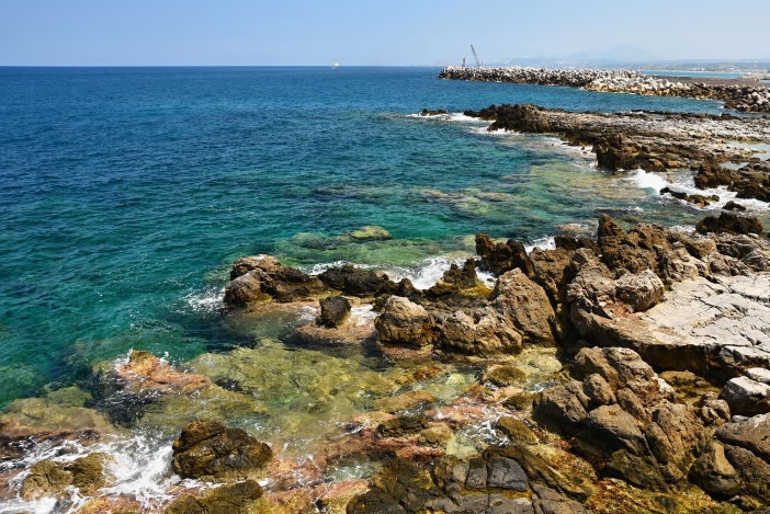 Beautiful clean sea and waves. Summer background for travel and holidays. Greece Crete.. Amazing scenery on the beach.