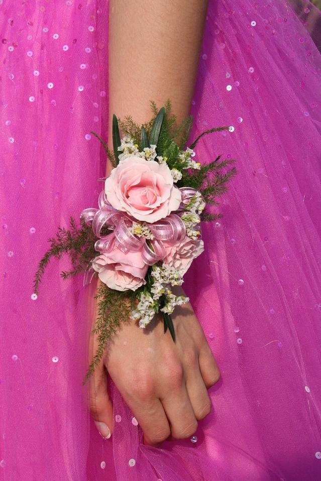 close-up-pink-dress-flower-arm-hand-1576956-639x958